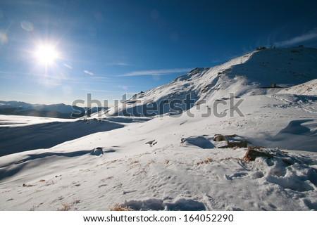 Snowshoe hiker northern Apennines ski resorts winter sports ski lifts and ski sports nature  - stock photo