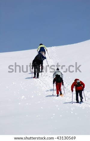 Snowshoe hiking. Alps, Italy. Winter