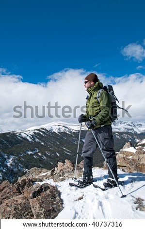 Snowshoer on the top of a trail - stock photo