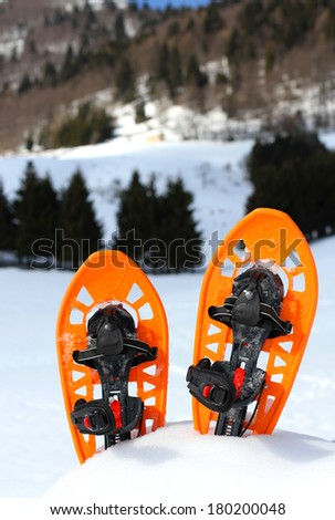 snowshoes for walking on the soft snow on the high mountain in winter - stock photo