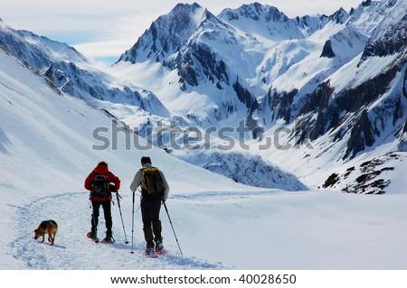 Snowshoes hiking, Dolomiti mountains, Alps, Italy. Winter - stock photo