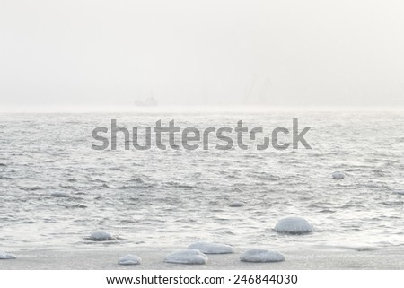 Snowstorm at sea - stock photo