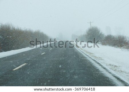 Snowstorm on highway near Yampa,  Colorado - stock photo