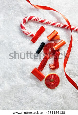 Snowy Background With Colorful Candies. Copy Space - stock photo