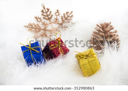 Snowy Background with gift boxes and snowflake