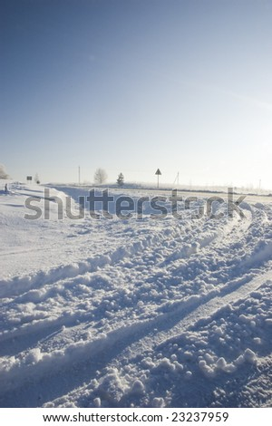 Snowy country road - stock photo