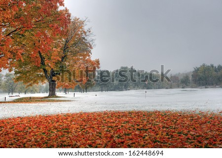 Snowy golf green in new hampshire during the fall. - stock photo