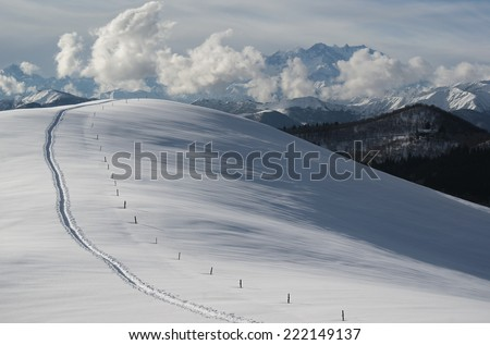 Snowy hill Fal�², Monte Rosa (4634m) in the background, Italy