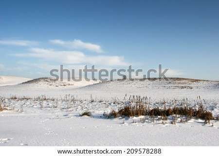 Snowy hills in the winter - stock photo