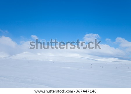 snowy horizon with clouds