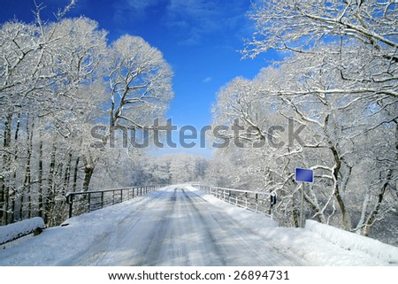 Snowy landscape - road and sign - stock photo