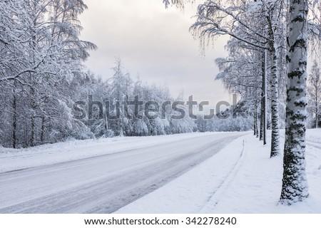 Snowy motor road - stock photo