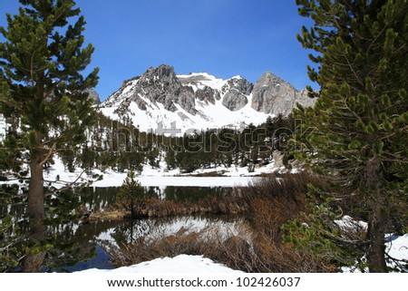 snowy mountain and lake in the Sierra Nevada mountains