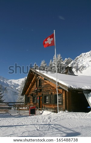 Snowy mountain cafe in winter time, Alps, Switzerland - stock photo