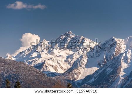 Snowy mountain peak. - stock photo