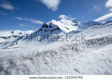 Snowy mountain peak along the Gross Glockner alpine road - stock photo