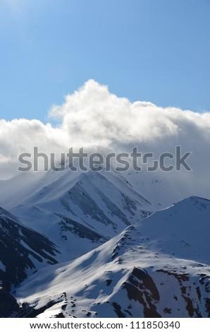Snowy mountain peaks - stock photo