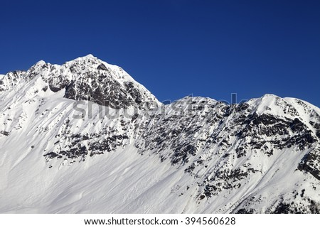 Snowy mountains and blue clear sky at cold sun day. Caucasus Mountains. Svaneti region of Georgia. - stock photo