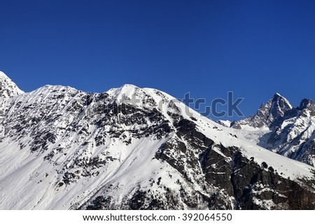 Snowy mountains and blue clear sky at nice sun day. Caucasus Mountains. Svaneti region of Georgia. - stock photo