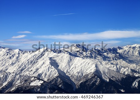 Snowy mountains and blue sky with clouds in nice sunny day. Caucasus Mountains. Svaneti region of Georgia.