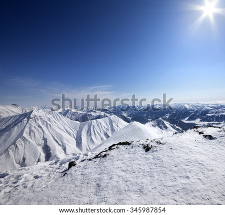 Snowy mountains at nice sun day. Caucasus Mountains, Georgia, ski resort Gudauri. - stock photo