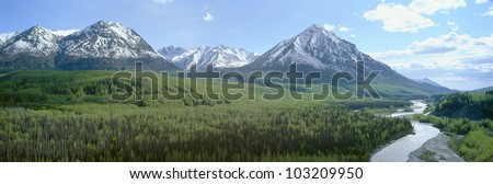 Snowy mountains, green forests and river in Matanuska Valley, Alaska