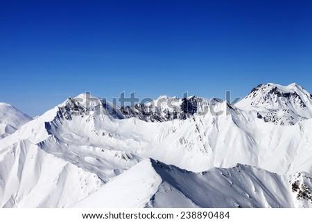 Snowy mountains in nice sun day. Caucasus Mountains, Georgia. View from ski resort Gudauri. - stock photo