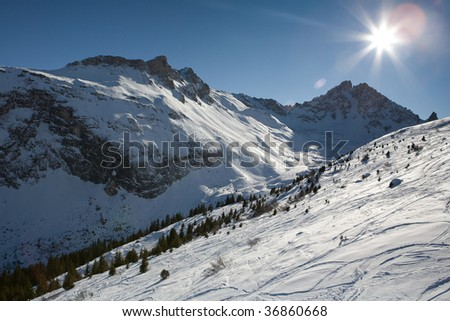 Snowy mountains in the French Alps - stock photo