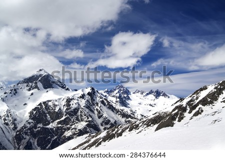 Snowy mountains in wind day. Caucasus Mountains, mount Semenov Bashi, ski resort Dombay.  - stock photo