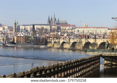 Snowy Prague Lesser Town with gothic Castle and Charles Bridge, Czech Republic