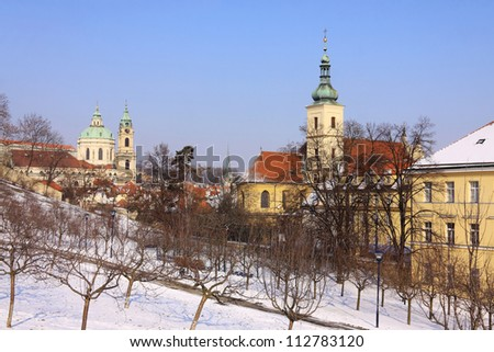 Snowy Prague St. Nicholas' Cathedral in the sunny Day, Czech Republic