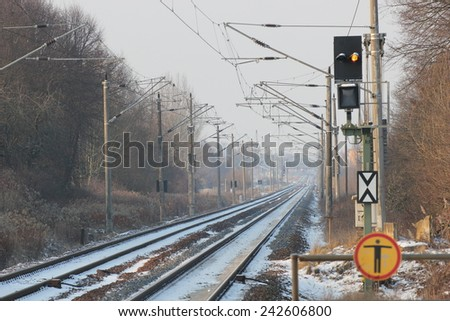 Snowy railtrack in Germany in winter on a winter day. - stock photo