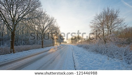 Snowy road at sunset