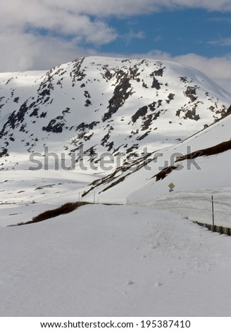 Snowy roads in a mountain area, Geiranger Norway - stock photo