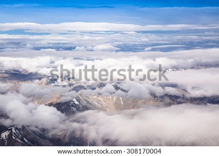 Snowy rock mountains cover with white cloud .Leh Dalakh,India