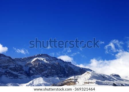 Snowy rocks at sun day. Greater Caucasus, Mount Shahdagh, Qusar rayon of Azerbaijan. - stock photo