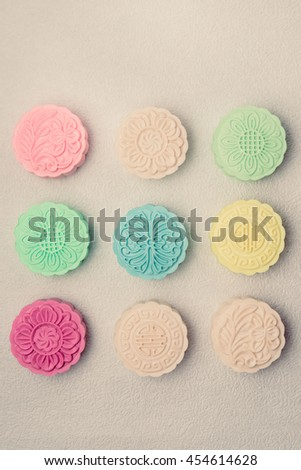 Snowy skin mooncakes. Chinese mid autumn festival foods. Traditional mooncakes on table - stock photo