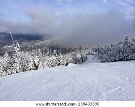 Snowy slope in the mountains  - stock photo