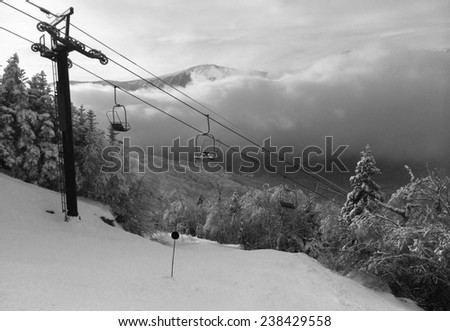 Snowy slope in the mountains, artistic version in black and white