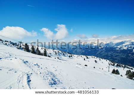 Snowy slopes in winter mountains. Skiing resorts