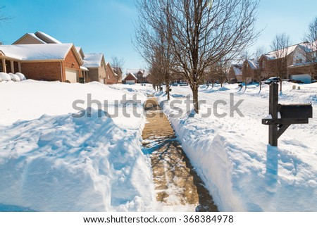 Snowy street in american suburbs , winter scenery. - stock photo