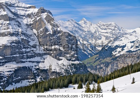 Snowy summits in the Jungfrau area, Swiss Alps - stock photo