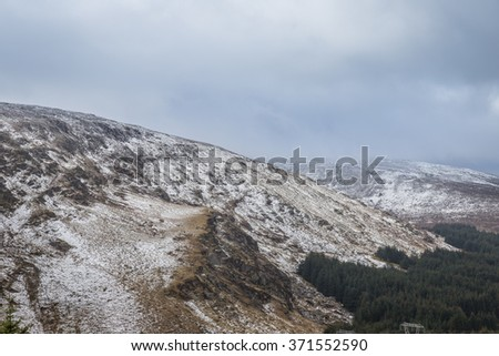 Snowy white and misty landscape in Wicklow Gap in Ireland - stock photo
