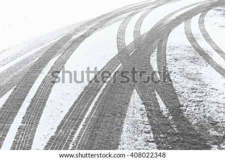 Snowy winter city road with tire trace - stock photo