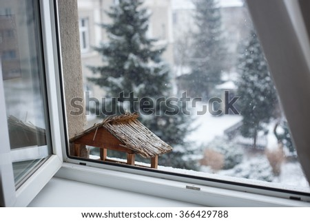 Snowy winter day behind the window