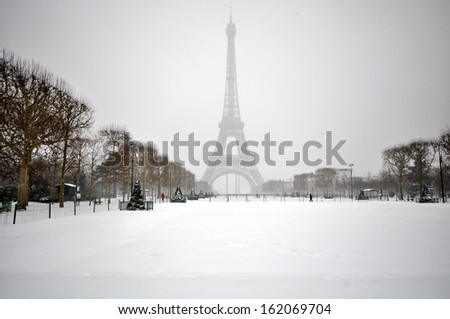 Snowy winter day in Paris - stock photo