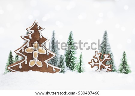 Snowy Winter Forest with gingerbread christmas tree