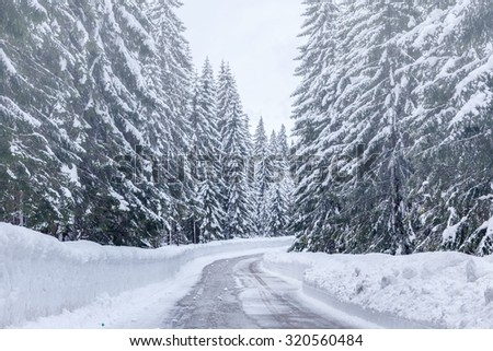 Snowy winter road in Julian Alps-Slovenia - stock photo