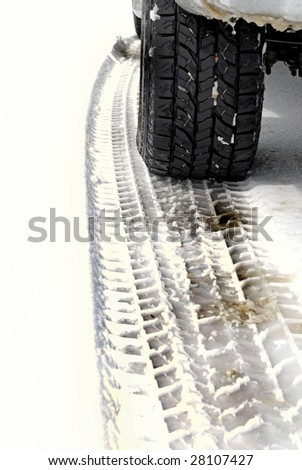 Snowy winter road with tire tracks in snow and tire