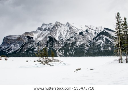 Snowy winter scenery in the Canadian Rocky Mountains - Lake Minnewanka Banff National Park, Alberta Canada